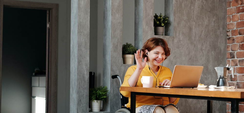 woman sitting at desk with latptop